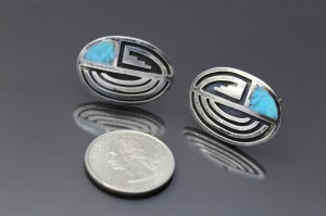 The large faced cufflinks are much bigger  1
