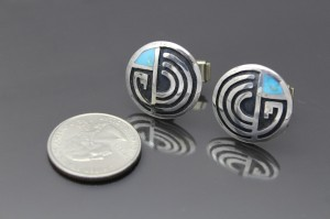 The large faced cufflinks are much bigger 2
